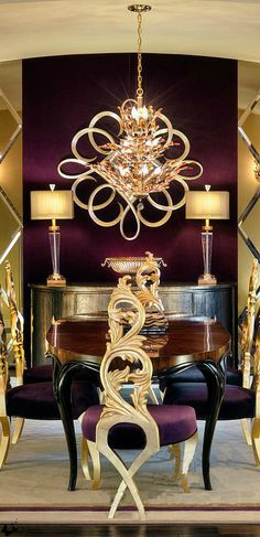 A beautifully detailed dining room. I love the gold accents against the dark chocolate wall. Viv