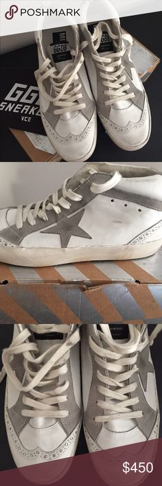 """Golden Goose Mid Star High Top Sneakers White Sz 9 Golden Goose Mid Star high top sneakers - made in Italy -distressed white leather with gray suede trim and star patch - brogue detailing at toes and heels - lace up front - GGDB logo tag on tongue- suede """"Golden"""" logo patch at heel - distressed base around shoes - grooved rubber bottoms - white leather foot beds with Golden Goose label patch - dust bag included - brand new in box - size 39 US 9 Golden Goose Shoes Sneakers"""