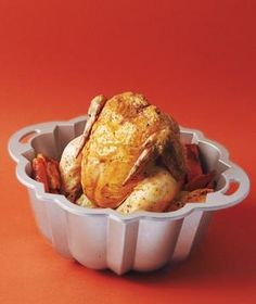 Bundt Pan as Vertical Roaster: For a juicy bird that's crispy all the way around, first layer potatoes, carrots, and onions on the bottom of the pan. Then season the chicken and place in the pan with the cavity over the center hole. Set the dish on a cookie sheet to collect any drippings and roast as usual.