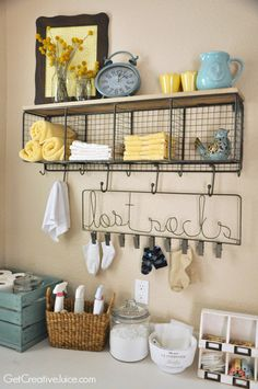 All it takes is a couple of extra hooks and storage spaces to organize a laundry room, as shown by Mindy from the Get Creative Juice blog with our Mesh Entry Organizer and Lost Socks Hook Rack.