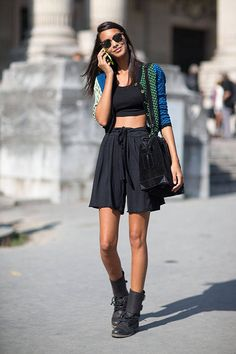 Parisian Chic: these girls find the perfect outfits for warm weather. See more Paris street style here.