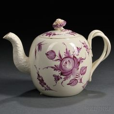 Wedgwood Cream-colored Earthenware Teapot and Cover, England, c. 1770, globular with entwined strap handle, foliate-molded spout and floral knop, puce enamel decorated with flowers, traces of