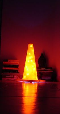 Traffic cone + a string of lights = lamp. I think this would be better outside, using outdoor xmas lights.
