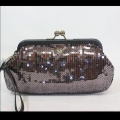 Authentic sequin coach clutch! JUST REDUCED Super cute clutch! Sequin blue/silver in color. Brand new. No tags. Never used. Great for the holidays! Coach Bags Clutches & Wristlets