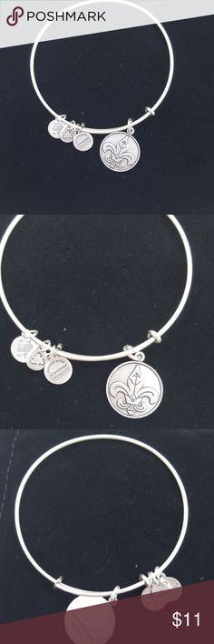 Alex and Ani adjustable bangle Fleur de Lis is the symbol Alex & Ani Jewelry Bracelets