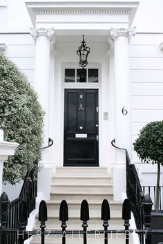#blackandwhite such an elegant entrance and the black door indicates career success #decorating