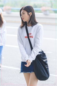 a simpleton in white sweaters with red print and denim mini