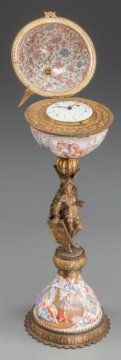 A FRENCH ENAMEL AND GILT BRONZE CLOCK, late 19th century.