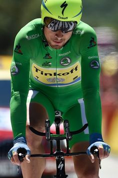 #TDF2016 Peter Sagan wearing the best sprinter's green jersey crosses the finish line of the 375 km individual timetrial the thirteenth stage of...