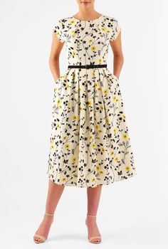 Soft crepe falls gracefully into the pleat neck bodice and knife-pleat skirt of our feminine floral print dress cinched in with a removable cotton poplin belt.
