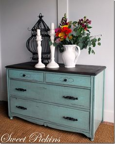 Blue dresser with black accents/top