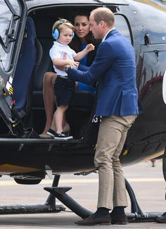 Prince George looks adorable while riding in a helicopter with mom and dad.