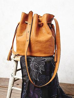 Bleeker Bucket Bag | This super sleek and textured versatile bucket bag is featured in a soft vegan leather with a drawstring closure and tassel accented ends.  The softest faux suede lining with a removable pouch insert.  Adjustable strap.