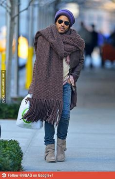 Lenny Kravitz has a big ass scarf, or a small carpet.