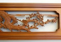 Japanese ranma, handcarved wood transom, at www.Jtansu.com  We have one of tis, with a much simpler carving