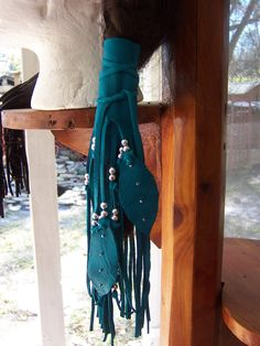 Native American  Turquoise Deerskin Leather With Silver beads Leather Feathers Hair Wrap. $14.95, via Etsy.