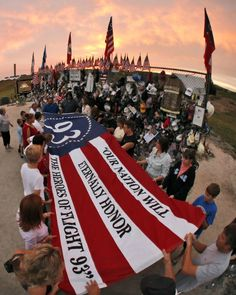 """Photo honoring United Airlines Flight 93 on Tributes.com. """"Visitors to the Flight 93 National Memorial in Shanksville, Pa., Monday Sept. 10, 2007 participate in a remembrance at sunset on the eve of the sixth anniversary of United Flight 93 crashing here on Sept. 11, 2001. """""""