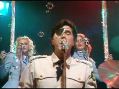 In my memory Bryan Ferry and Roxy Music played The Roxy on Sunset in the mid 1970s. He and the gals were dressed in white Navy uniforms. They walked right past us before going on stage - Love Is The Drug