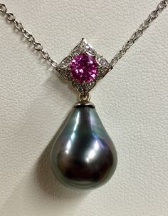 #pearl and pink #sapphire designer pendant embellished with #diamonds