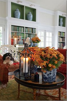 Carolyne Roehm The colors of fall mums are the essence of autumn and not just for planting outdoors. Bring potted mums indoors in blue ...