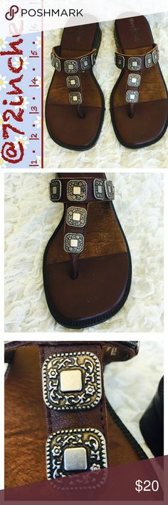 "Minnetonka Embellished Leather Thong Sandals 💥 Savor the summer sunshine in these beautiful embellished sandals.  Leather upper with riveted metallic ornaments. Side elastic gore for a flexible fit.  Manmade sole with 1-1/4"" heel height. Shows only minor wear. Minnetonka Shoes Sandals"