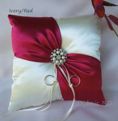 Wedding ring bearer pillow, Ivory with a red sash ring pillow, Red ring bearer pillow, Ivory ring pillow, Wedding ring pillowWedding ring bearer pillow and flower girl by duboisbridaldesigns rings ringsandringsIdeas for wedding rings box redGift Ideas Any Bow Pillows, Ring Pillows, Wedding Pillows, Ring Pillow Wedding, Pillow Crafts, Ring Bearer Pillows, Cushion Ring, Pillow Design, Decorative Pillows