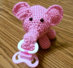 Mom look at this !!!!   :). Crochet Pink Elephant Pacifier Holder. Must figure out how to make this!