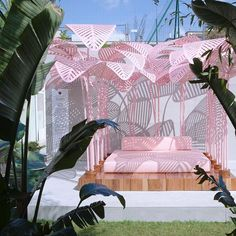 Relax on a cushiony bed under pink palm tree leaves! - Le Refuge Outdoor by Marc Ange