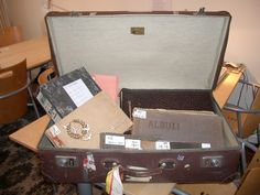 Sitting on a shelf in the Expatriate Archive Centre's study room is an old suitcase with a faded Shell label tied to its handle. Its base is battered and warped from years of travel, its paper lini… Old Suitcases, Centre, Archive, Memories, Memoirs, Souvenirs, Remember This