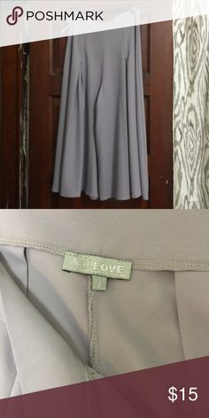 """Wide flowy grey culottes Gorgeous flowy culottes in a pretty purplish grey color. Very pretty flattering style. Has a side zipper with two buttons. I'm usually a size 8 bottoms but my waist is small and these fit me perfectly just aren't really my style. I have a 27.5"""" waist and 41"""" hips and they fit. Very flowy and forgiving around hips/butt. Asos Pants Wide Leg"""