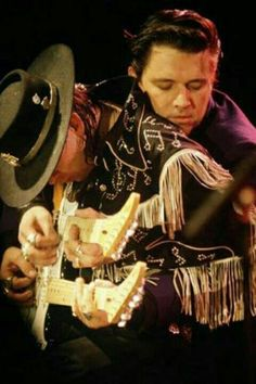 "Repinning, because it deserves it: Stevie Ray and brother Jimmie Vaughan playing (probably ""Pipeline"") on the same 1981 Robin Octave Double Neck guitar."