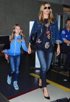 Heidi Klum arrives on a flight at LAX Airport with her daughter Leni on May 17, 2015