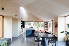 moloney architects' two halves house features two equally-sized timber pavilions