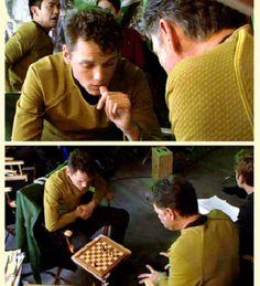 Anton Yelchin and Bruce Greenwood playing chess on the set of Star Trek. You can kinda see John Cho and Chris Pine