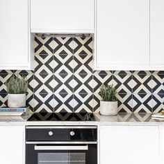 A dramatic tile with a distinctive diamond motif. The Vigo tile is based on a traditional design and will add geometric punch to both traditional and contemporary spaces. Black and white tiles are a design classic. Black And White Backsplash, White Wall Tiles, White Bathroom Tiles, Black And White Tiles, Kitchen Wall Tiles, Kitchen Floor, Kitchen Backsplash, Red Black, Bert And May Tiles