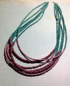 turquoise and purple multiline necklace made of plastic beads