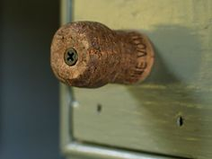 repurposed champagne/wine cork into a drawer knob (or towels hanger in the kitchen)! Easy!