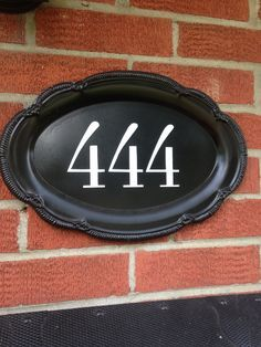 Cheap silver platter spray painted black with numbers written on it. Cheap silver platter spray painted black with numbers written on it. Silver Platters, Silver Trays, Silver Tray Decor, Outdoor Projects, Home Projects, Living At Home, Cottage Living, Porch Decorating, Cheap Home Decor