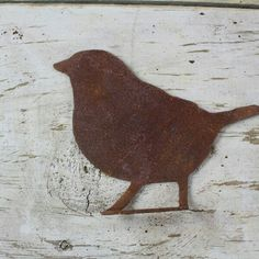 MOUNTED SITTING BIRD  Mounted Bird Shape perched bird.   Shape is bent to be attached to a horizontal surface