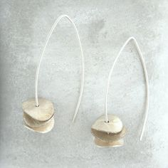 ORCHID earrings. Three silver petals on an eye shaped silver wire. on Etsy, $44.00
