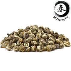 """Premium Jasmine Dragon Pearls Green Tea: Our jasmine """"Dragon Pearl"""" green tea is a deliciously sweet green tea that combines the absolute highest quality tea with a sweet jasmine aroma and taste.  Completely hand crafted into small pearls, this tea is amazing to drink and watch as it brews."""
