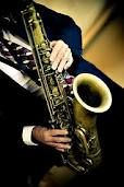 Saxophone. We will have a guy playing the sax Friday night at the Welcome Reception.