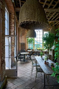 'Derelict chic' is the description of The Folly, an indoor/outdoor dining area in the garden.