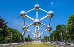 #UnusualBuildings - The Atomium- Brussels, #Belgium. The Atomium is a building in Brussels originally constructed for Expo '58, the 1958 Brussels World's Fair. Designed by the engineer André Waterkeyn and architects André and Jean Polak, it stands 102 m (335 ft) tall. Its nine 18 m (59 ft) diameter stainless steel clad spheres are connected so that the whole forms the shape of a unit cell of an iron crystal magnified 165 billion times.