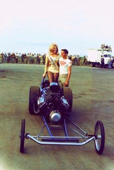 Old school front engined dragster, and Linda Vaughn, Miss Hurst Golden Shifter.
