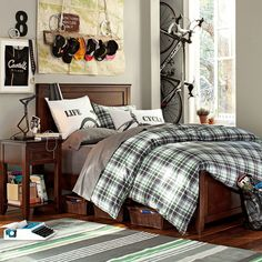 Appealing Teenage Boys Bedroom Design Idea For Small Space With Classic Brown Bed Frame And Bedside Table And Patterned Bedding And Carpet Also Mountain Bike And Some Wall Display And Wooden Floor - Use J/K to navigate to previous and next images