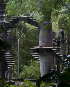 """Amazingly surreal Las Pozas in the rainforest by Xilitla in the Mexico mountains. Created by Edward James in the 40′s, it includes more than 80 acres of natural waterfalls and pools interlaced with towering surrealist sculptures and buildings. The many trails throughout the garden site are composed of steps, ramps, bridges and narrow, winding walkways that traverse the valley walls. It was supposed to be a """"Garden of Eden"""" containing a huge variety of plants and animals."""