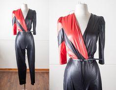 80s Futuristic Black Jumpsuit   Sexy Wet Look Jumpsuit Color Block Playsuit Avant Garde Black Catsuit Vintage 70s Jumpsuit Wrap Around Retro by BlueHorizonVintage on Etsy