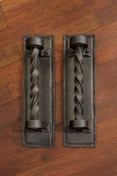 Exquisite craftsmanship, these custom ironwork handles feature a twisted rope design. Brought to you by the artisan blacksmiths of Noble Forge.