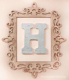 monogram wall decor - the scroll frames are sold at Michaels!!